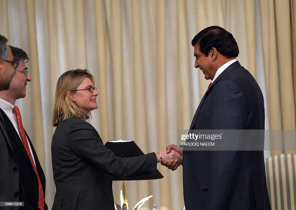 Pakistani Prime Minister Raja Pervez Ashraf (R) greets British Secretary of State for International Development, Justine Greening before a meeting in Islamabad on January 22, 2013. Greening arrived in Islamabad to meet Pakistani leaders of mutual interest. AFP PHOTO/Farooq NAEEM