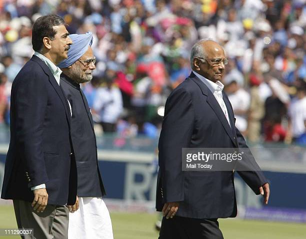 Pakistani Prime Minister Yousuf Raza Gilani and Manmohan Singh along with Sharad Pawar walks back after meeting players before the start of the ICC...