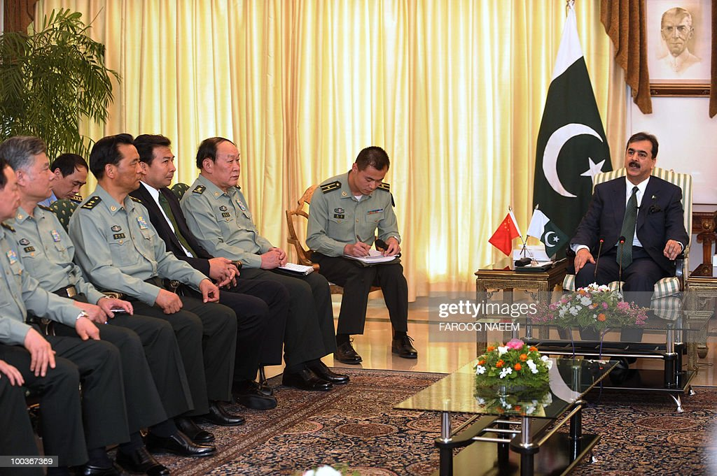 Pakistani Prime Minister Yusuf Raza Gilani (R) talks with the Chinese Defence delegation led by Defence Minister, General Liang Guangile (2C) during a meeting in Islamabad on May 24, 2010. China agreed to provide four trainer aircraft for the Pakistan Air Force and 60 Million Yuan (8.8 million USD) for undertaking professional training of the Armed Forces of Pakistan. AFP PHOTO/Farooq NAEEM