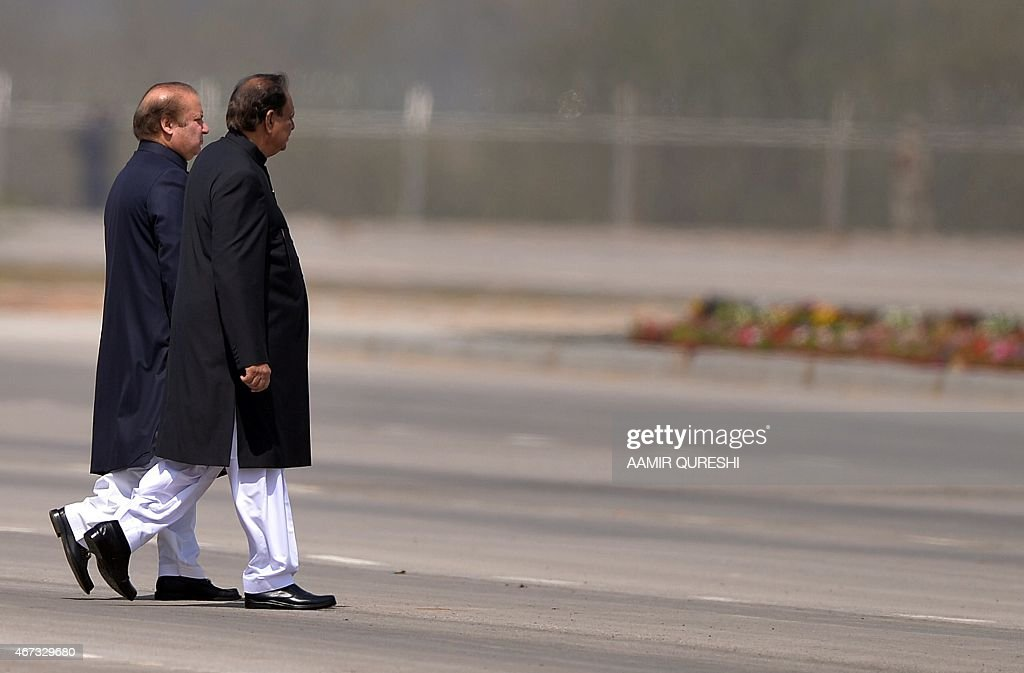 Pakistani Prime Miniter Nawaz Sharif (L) and President <a gi-track='captionPersonalityLinkClicked' href=/galleries/search?phrase=Mamnoon+Hussain&family=editorial&specificpeople=11183703 ng-click='$event.stopPropagation()'>Mamnoon Hussain</a> arrive to meet with children during the Pakistan Day military parade in Islamabad on March 23, 2015. Pakistan held its first national day military parade for seven years, a display of pageantry aimed at showing the country has the upper hand in the fight against the Taliban. Mobile phone networks in the capital were disabled to thwart potential bomb attacks, some roads were closed to the public and much of the city was under heavy guard for the event. AFP PHOTO/ Aamir QURESHI