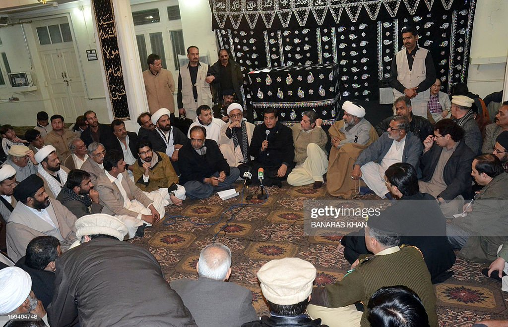 Pakistani Primer Minister Raja Pervez Ashraf (C) prays, with Shiite Muslim mourners, for blast victims who were killed in recent twin suicide bombings in Quetta early on January 14, 2013. Thousands of Shiite Muslims from Pakistan's minority Hazara community ended a nearly four-day protest after Islamabad caved into their demands for protection by sacking the provincial government. Protesters refused to bury the victims of Pakistan's worst single attack on Shiites, which killed 92 people in the southwestern city of Quetta last January 10.