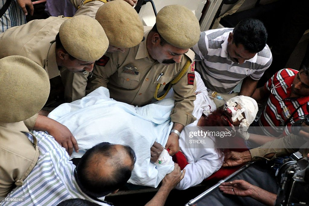 Pakistani prisoner Sanaullah, an inmate of India's central Jammu jail that was attacked by Indian inmates at a prison, is carried from a hospital to an ambulance in Jammu on May 3, 2013, before being transferred to a hospital in Chandigarh for treatment. A Pakistani prisoner suffered serious head injuries after being attacked in an Indian jail in apparent tit-for-tat violence following the death of an Indian inmate in Pakistan, a prison official said.
