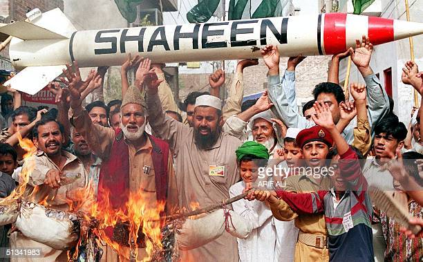 Pakistani protestors burn an effigy of Indian Prime Minister Atal Behari Vajpayee while holding replica of surfacetosurface Shaheen missile in...