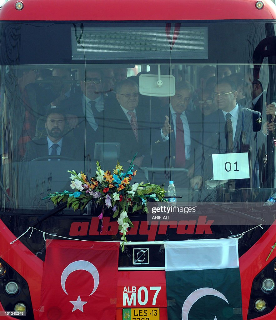 Pakistani Punjab province Chief Minister Shahbaz Sharif (2R) and Turkish deputy prime minister Bekir Bozdag (R) stand in a Metro Bus during the launch ceremony of the Metro Bus system in Lahore on February 10, 2013. Authorities in Pakistan on Sunday launched a 'Metro Bus' system in the second largest city, Lahore, the restive country's first major urban public transport scheme. AFP PHOTO/Arif ALI