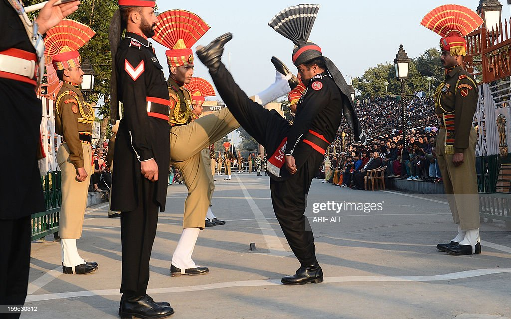 Pakistani Rangers and Indian Border Security Force personnel perform the 'flag off' ceremony at the PakistanIndia Wagah Border Post on January 15...