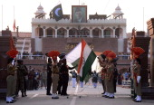 Pakistani Rangers and Indian Border Security Force personnel perform the daily retreat ceremony on the IndiaPakistan Border at Wagah on December 10...