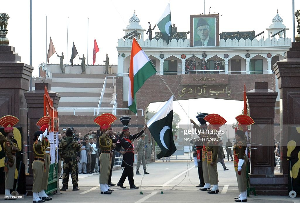 Pakistani Rangers and Indian Border Security Force personnel perform the flag off ceremony during India's 66th Republic Day at the IndiaPakistan...