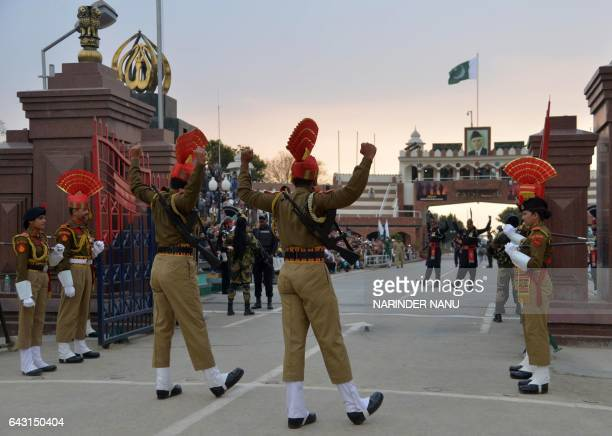 Pakistani Rangers and Indian Border Security Force personnel perform during the daily beating of the retreat ceremony on the IndiaPakistan Border at...