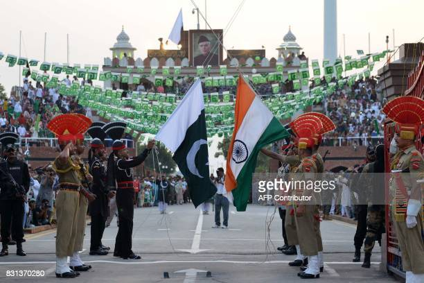 Pakistani Rangers and Indian Border Security Force personnel perform perform during the daily beating of the retreat ceremony at the IndiaPakistan...