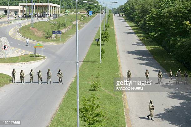 Pakistani Rangers cordon off the area near the US embassy in Islamabad on September 21 2012 Angry demonstrators set fire to two cinemas in Pakistan's...