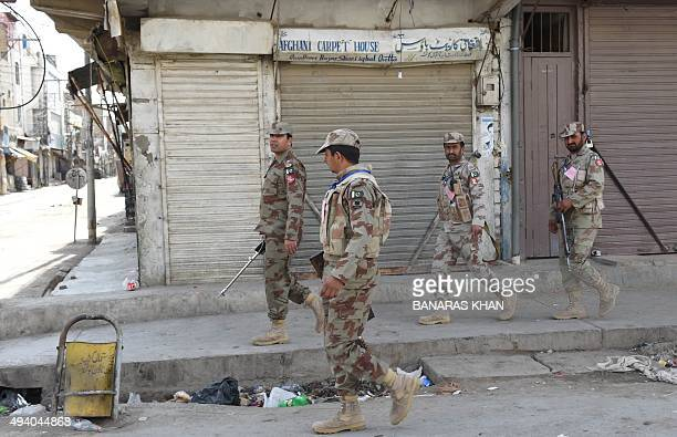 Pakistani Rangers security personnel patrol during an Ashura procession to commemorate the martyrdom of Imam Hussain the grandson of Prophet Muhammad...