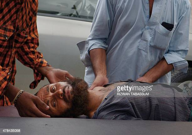 Pakistani relatives bring a heatstroke victim to a hospital in Karachi on June 25 2015 The death toll from a major heatwave in Pakistan passed 1000...