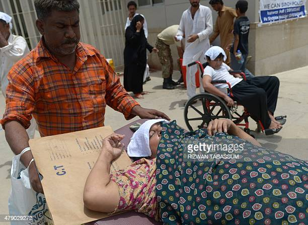 Pakistani relatives care for a heatstroke victim at a hospital in Karachi on June 30 2015 Nearly twothirds of the victims of a killer heatwave that...