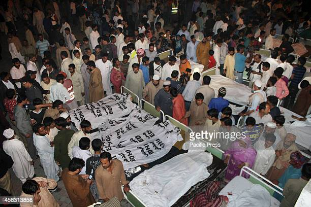 Pakistani relatives mourn over the death of their loved ones at a local hospital after a suicide bomb attack near the Wagah border paramilitary...