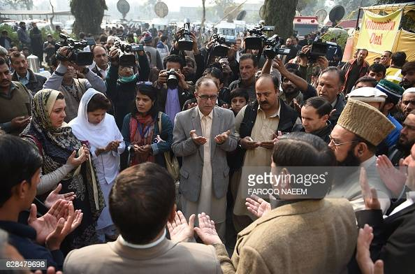 Pakistani relatives of some of the victims of a plane crash offer prayers at the Pakistan Institute of Medical Sciences hospital in Islamabad on...