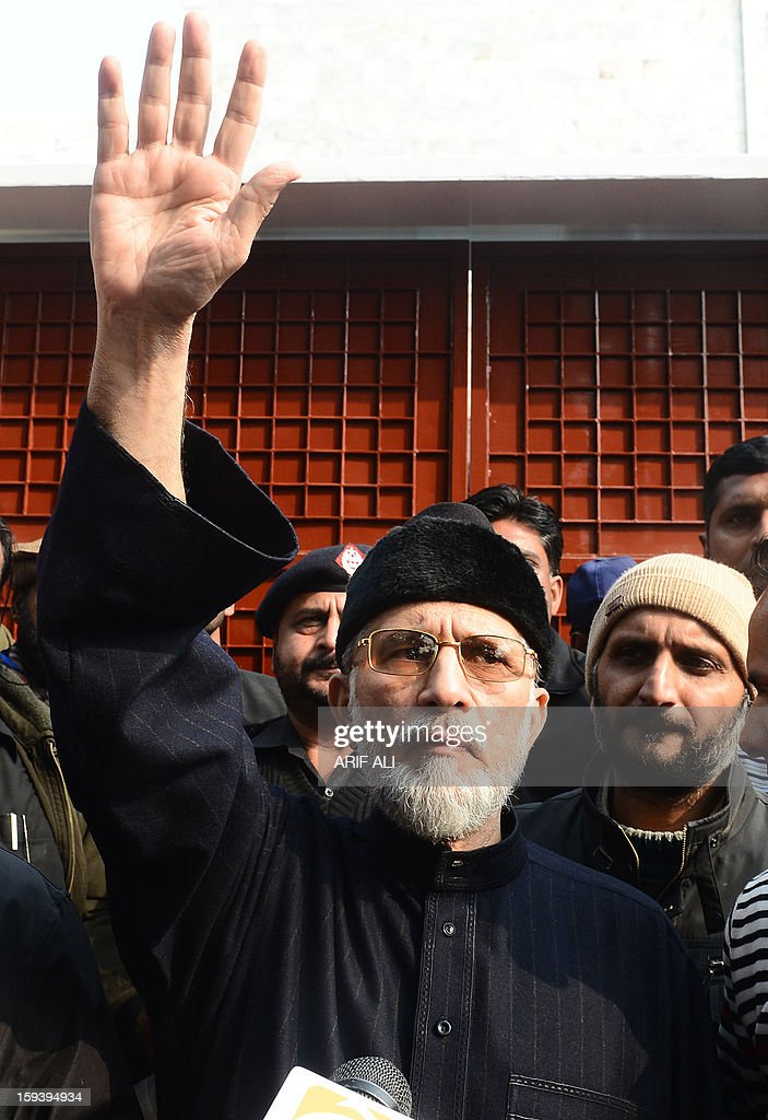 Pakistani religious leader Tahir-ul Qadri talks with media representatives before the start of protest march in Lahore on January 13, 2013. An influential Pakistani preacher lead thousands of supporters at the start of a protest march on the capital Islamabad to demand key reforms before looming elections. AFP PHOTO/ Arif ALI