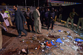 Pakistani rescuers and officials gather at a bomb blast site in Lahore on March 27 2016 At least 25 people were killed and dozens injured when an...