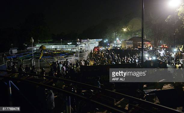 Pakistani rescuers and officials gather at a bomb blast site in Lahore on March 27 2016 At least 56 people were killed and more than 200 injured when...