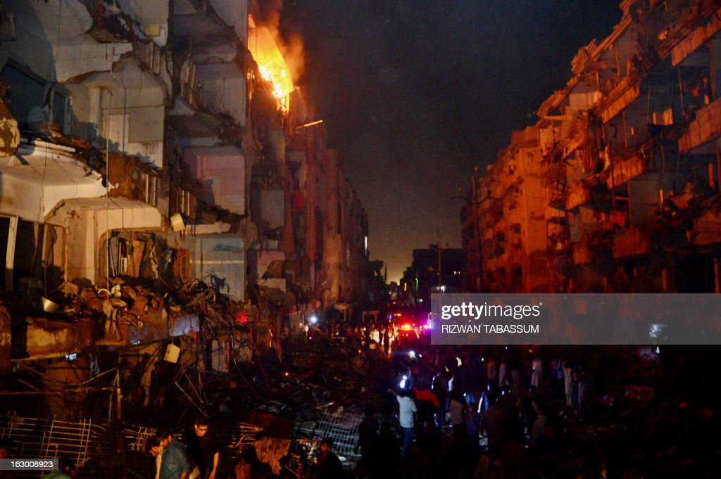 Pakistani rescuers gather at the site of the bomb blast in Karachi on March 3, 2013. A bomb attack in Pakistan's largest city Karachi on Sunday killed at least 23 people, including women and children, and wounded 50 others, police said. AFP PHOTO/ RIZWAN TABASSUM