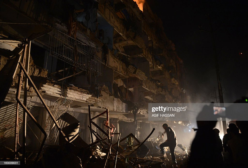 Pakistani rescuers search for victims at the site of the bomb blast in Karachi on March 3, 2013. A bomb attack in Pakistan's largest city Karachi on Sunday killed at least 23 people, including women and children, and wounded 50 others, police said. AFP PHOTO/Asif HASSAN