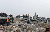 Pakistani rescuers search for victims in the rubble of a collapsed factory on the outskirts of Lahore on November 5 2015 Pakistani rescuers have...