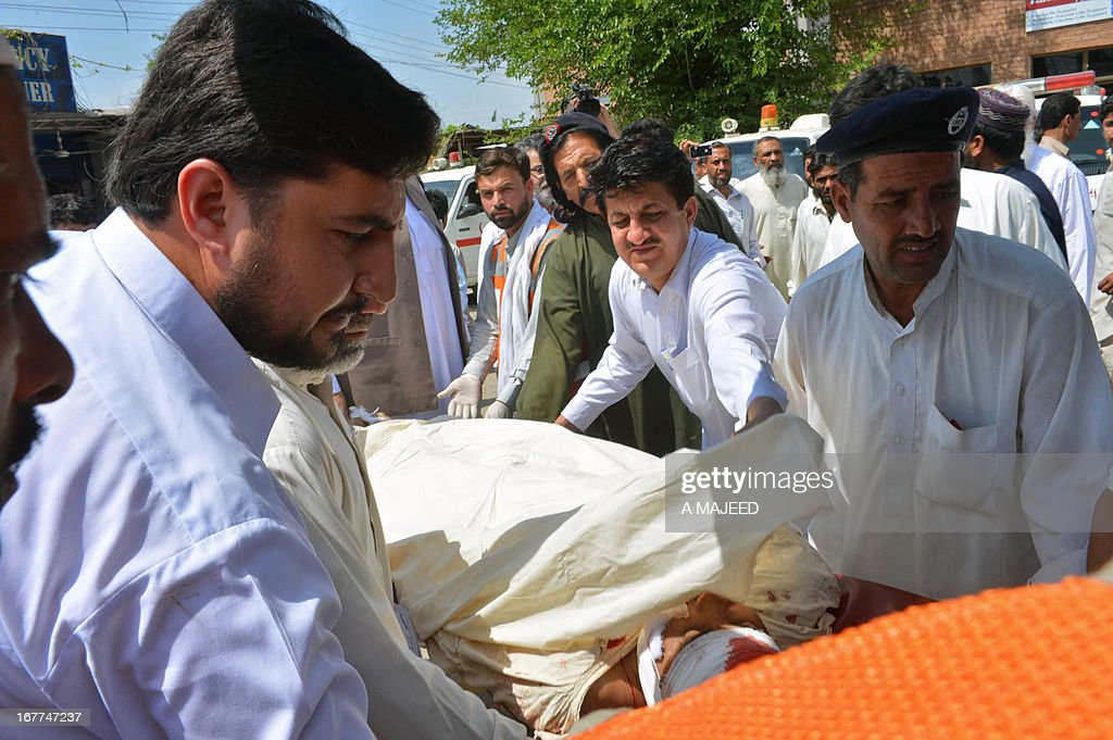 Pakistani rescuers shift an injured bomb blast survivor into a hospital in Peshawar on April 29, 2013. A suicide bomber killed at least eight people and wounded 45 others when he rammed his motorcycle into a bus in Pakistan's northwestern city of Peshawar on Monday, police said.