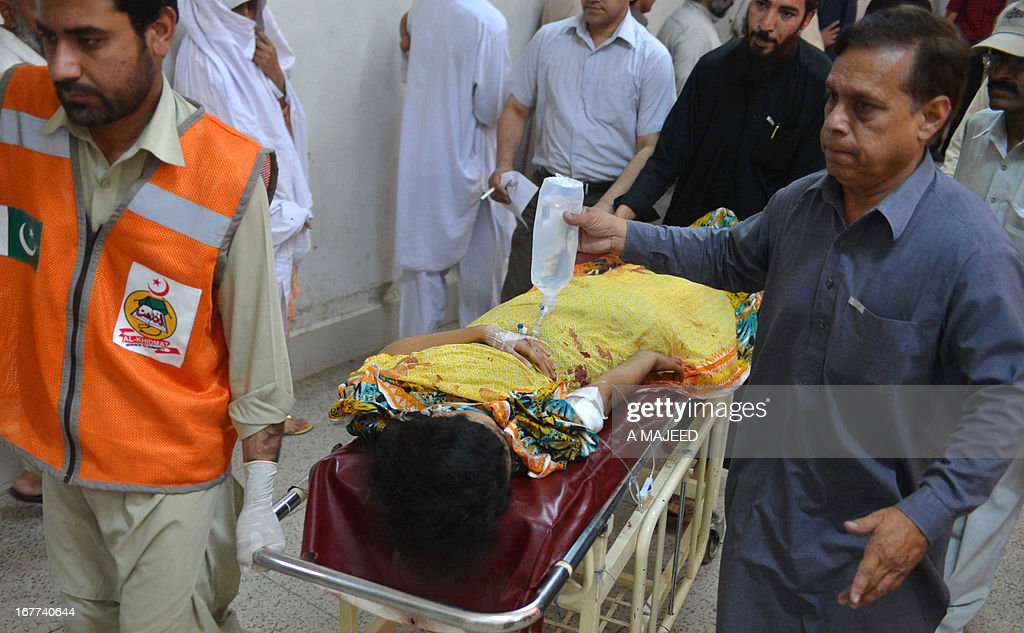 Pakistani rescuers shift an injured girl into the hospital following a bomb blast in Peshawar on April 29, 2013. A suicide bomber killed at least eight people and wounded 45 others when he rammed his motorcycle into a bus in Pakistan's northwestern city of Peshawar on Monday, police said. AFP PHOTO/A MAJEED