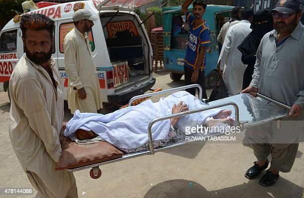 Pakistani residents carry a heatstroke victim to a hospital in Karachi on June 23 2015 More than 450 people have died from a threeday heatwave in...