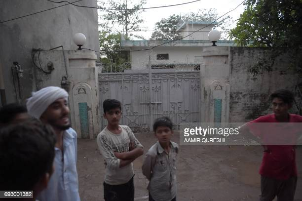 Pakistani residents gather in front of the former family house of Khuram Shazad Butt identified as one of the three London attackers in Jhelum on...