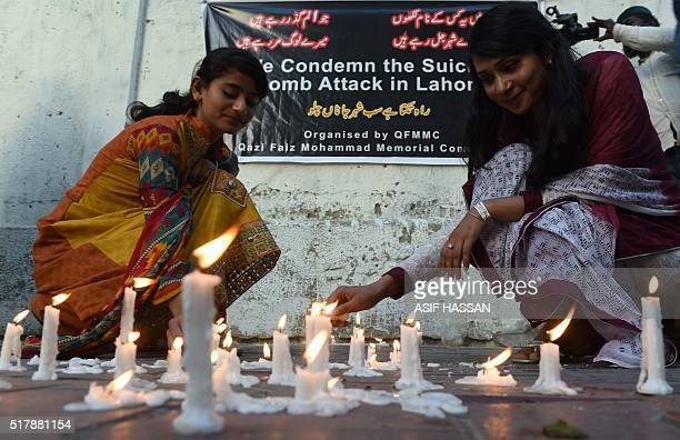 Pakistani residents light candles to pay tribute to the victims of the March 27 suicide bombing in Karachi on March 28 2016 Pakistan's army launched...