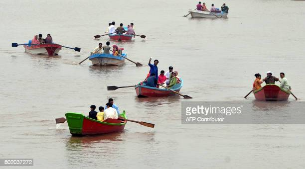 TOPSHOT Pakistani residents ride on boats at the Rawal Dam in Islamabad on June 27 on the second day of Eid alFitr holiday that marks the end of the...