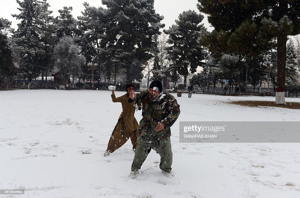 Pakistani residents take part in a snowball fight at a park in Quetta on January 8, 2014. The valley of Quetta received its first snowfall of the winter. AFP PHOTO/Banaras KHAN