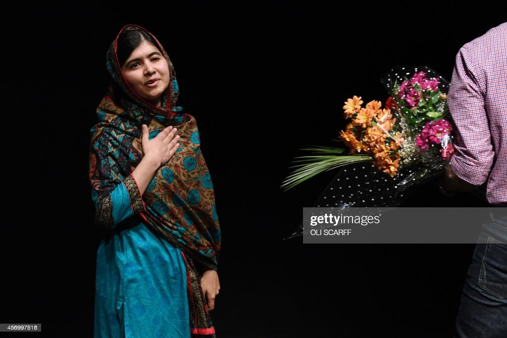 Pakistani rights activist Malala Yousafzai gestures after addressing the media in Birmingham central England on October 10 2014 The Nobel Peace Prize...