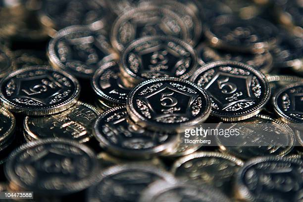 Pakistani rupee coines are arranged for a photograph in Karachi Pakistan on Friday Sept 24 2010 Pakistan's central bank seeking to double Islamic...