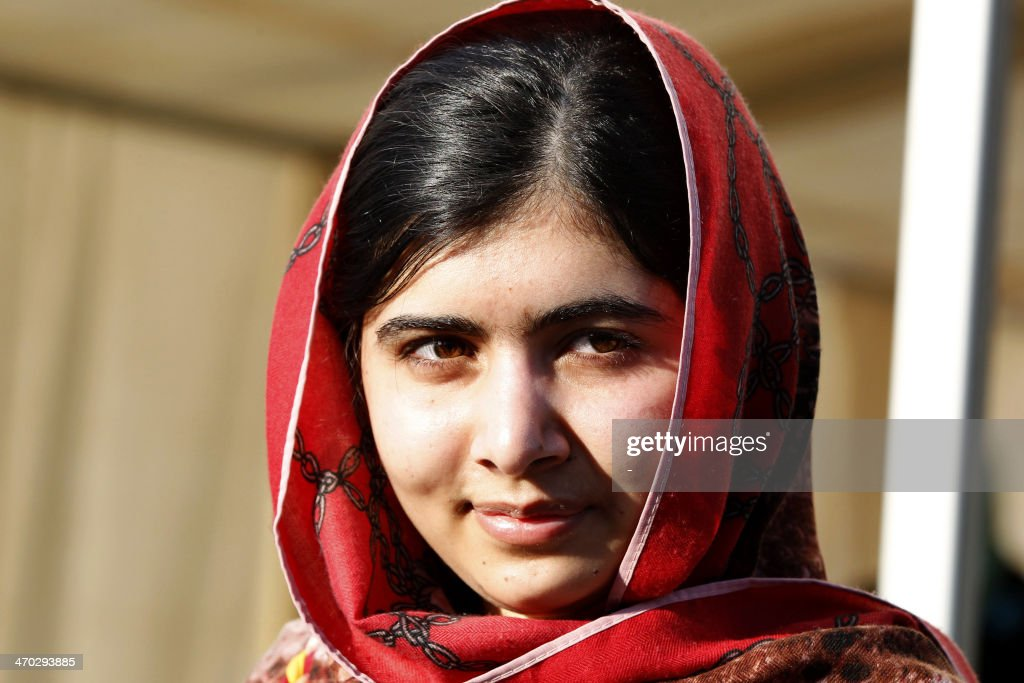 Pakistani schoolgirl <a gi-track='captionPersonalityLinkClicked' href=/galleries/search?phrase=Malala+Yousafzai&family=editorial&specificpeople=5849423 ng-click='$event.stopPropagation()'>Malala Yousafzai</a>, who survived being shot in the head by the Taliban, leaves after attending a press conference at the Zaatri refugee camp, near the Jordanian border with Syria, on February 18, 2014. Yousafzai was nominated for the World Children's Prize in Sweden this month for championing education rights for girls. AFP PHOTO/STR
