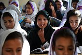 Pakistani schoolgirls attend class after offering prayers for Nobel Peace Prize laureate Malala Yousafzai during a school assembly in Mingora in the...