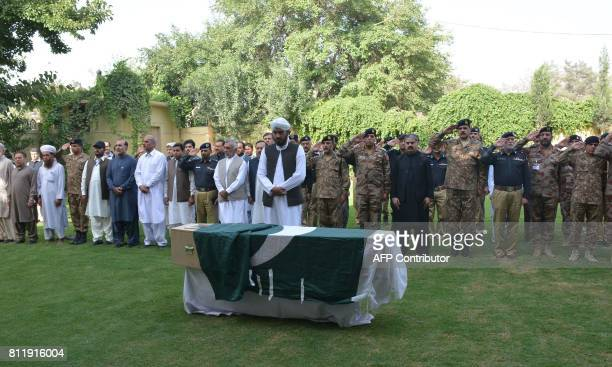 Pakistani security and government officials offer funeral prayers for senior police officer Sajid Khan Mohmand who was killed in a bomb explosion...