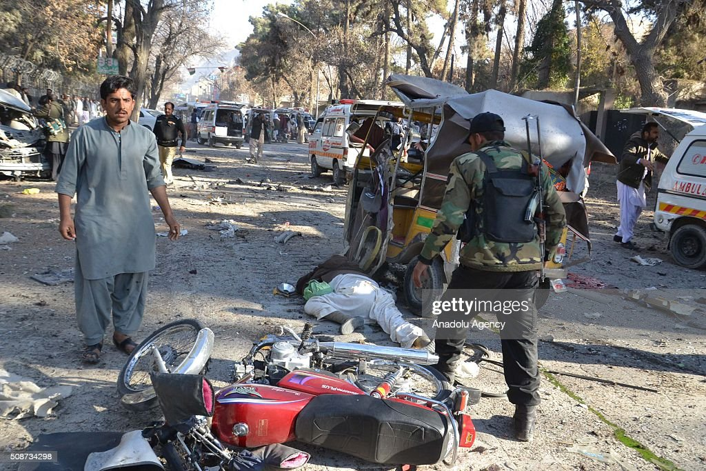 Pakistani security forces are seen at the site of a suicide attack in Quetta, Pakistan, on February 6, 2016. At least nince people were killed and several others wounded in the suicide attack near the premises of the heavily guarded Quetta district courts on Saturday.