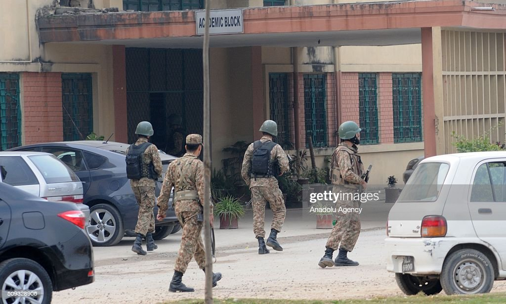 Pakistani security forces are seen on duty at the Vaqar-un-Nisa Girls College building after suspects tried to barged into the school following fire exchange between suspects and police in Rawalpindi, Pakistan on February 10, 2016. As gun shots were heard near the college, the students rushed towards the gate then caused stampede in which some students were injured.