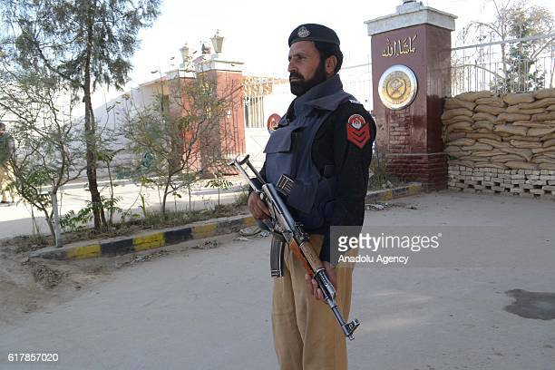 Pakistani security forces stand guard outside the Balochistan Police Training College in Quetta on October 24 after militants attacked the training...