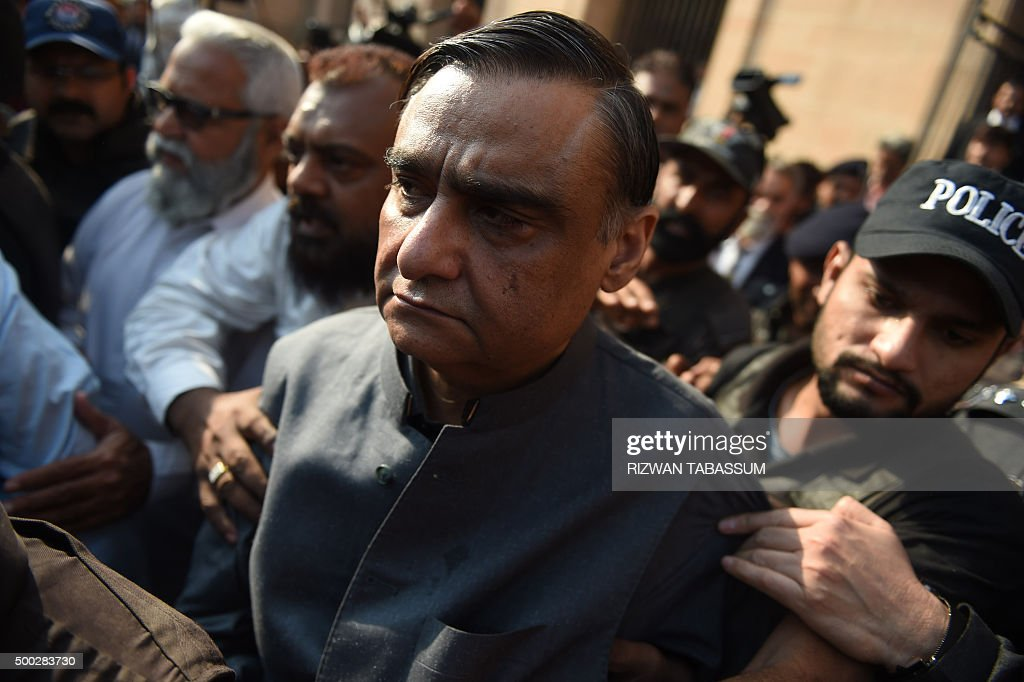Pakistani security officials escort ex-petroleum minister <b>Asim Hussain</b> (C), <b>...</b> - pakistani-security-officials-escort-expetroleum-minister-asim-hussain-picture-id500283730