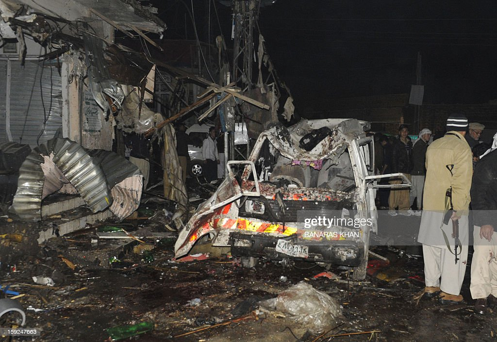 Pakistani security officials examine the site of a bomb attack in Quetta on January 10, 2013. At least 10 people were killed as two successive bombs exploded outside a snooker club in the southwestern city of Quetta late, hours after a separate blast left 11 dead, police said.