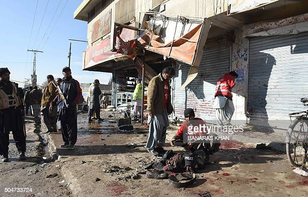 Pakistani security officials examine the site of a bomb blast near a polio vaccination centre in Quetta on January 13 2016 At least 15 people were...