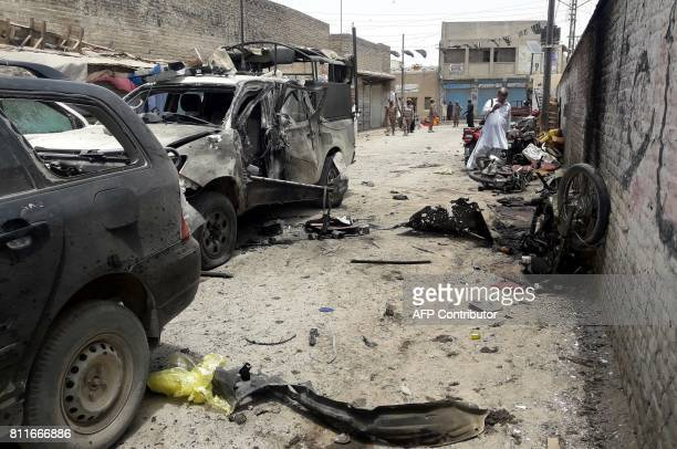 Pakistani security officials gather at the site of a bomb explosion targeting the police chief in the border town of Chaman on July 10 2017 A bomb on...