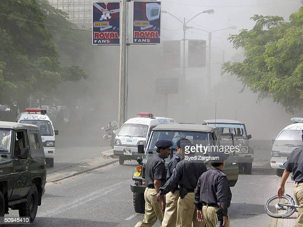 Pakistani security personal cordon off the area where unknown assailants attack on an Army jeep while smoke of blast raise in the back ground June 10...