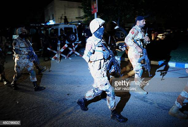 Pakistani security personnel arriveat the militants assault site of the Jinnah International Airport in Karachi on late June 8 2014 Heavily armed...