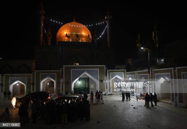 Pakistani security personnel gather at the 13th century Muslim Sufi shrine of Lal Shahbaz Qalandar a day after a bomb attack in the town of Sehwan in...