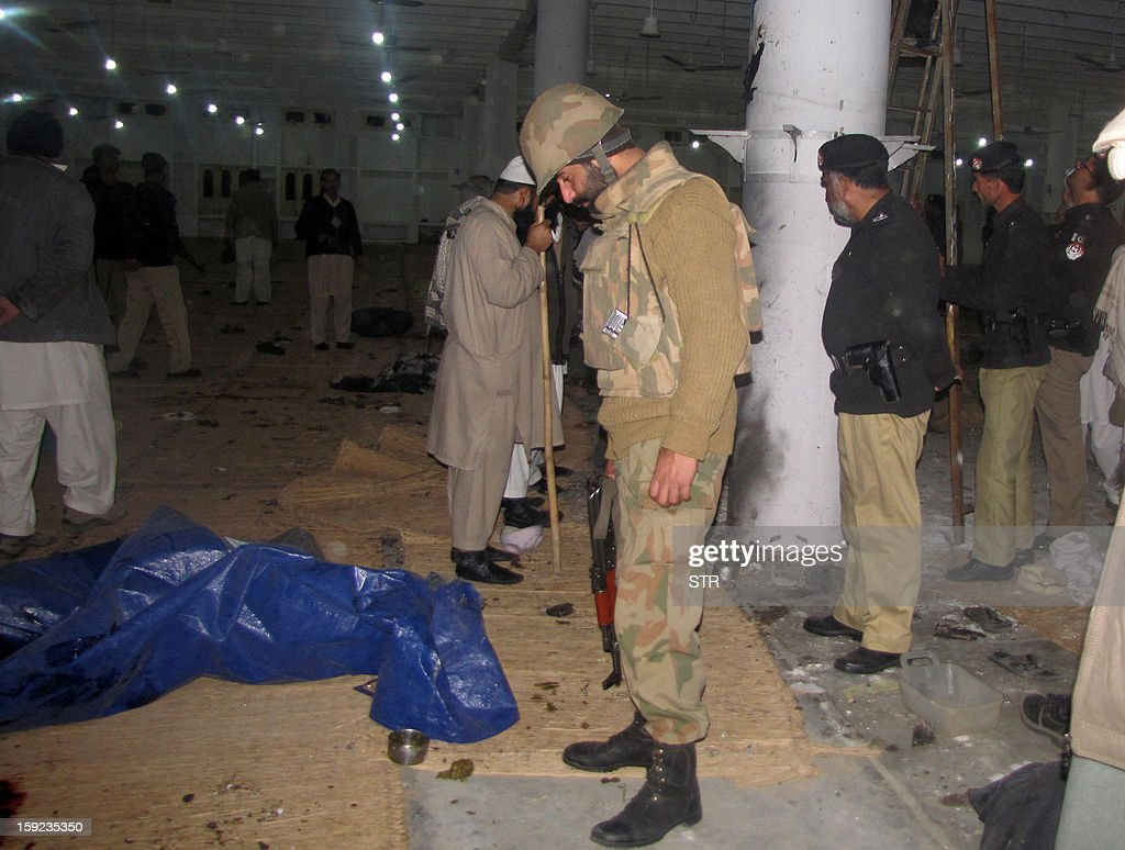 Pakistani security personnel inspect a religious seminary after a gas explosion in the outskirts of Mingora, the main town in the district, on January 10, 2013. At least 13 people were killed when a gas cylinder exploded at a religious gathering in Pakistan's northwestern Swat valley on Thursday, officials said.