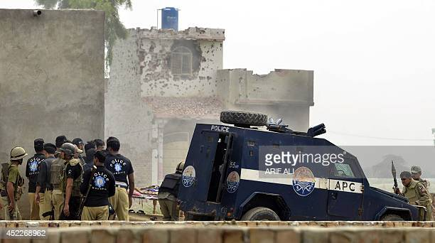Pakistani security personnel prepare for an attack during a raid on a militant hideout in Lahore on July 17 2014 Pakistani security forces laid siege...