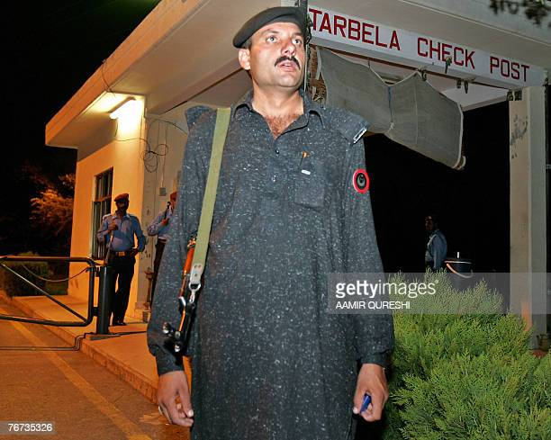 Pakistani security personnel stand alert at a checkpost near the headquarters of an anti AlQaeda Special Operation Task Force where a suicide bomber...
